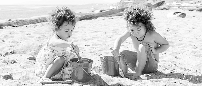 Photography of Girls on beach with sand pails